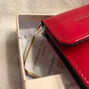 Adrienne Vittadini Bags - 👜Adrianne Vittadini Patent Red wallet👜